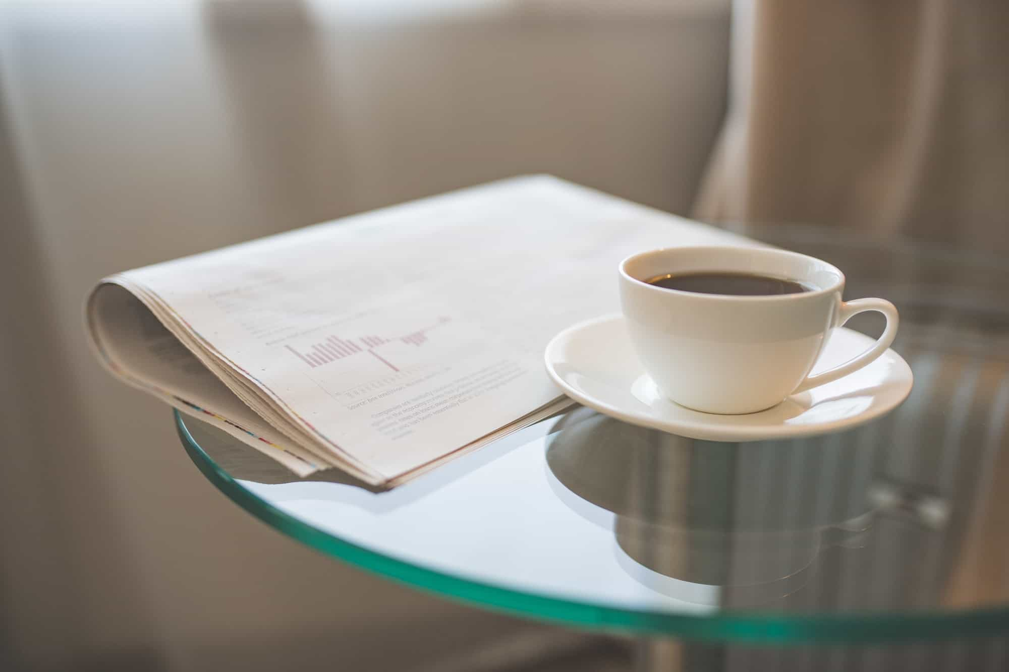 A cup of coffee and a newspaper